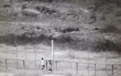 Surveillance footage showing 2 Palestinian men attempting to breach the border fence and enter Israeli territory on June 2, 2018. (IDF)