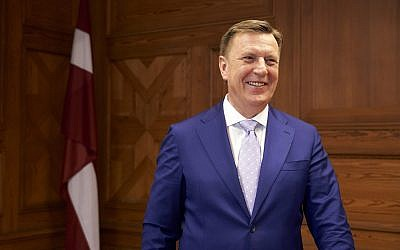In this photo taken on April 10 2018, Latvia's Prime Minister Maris Kucinskis poses for a photograph, during an interview, in Riga. (AP Photo/David Keyton)