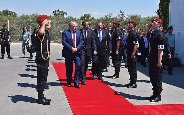Israeli Defense Minister Avigdor Liberman, flanked by his Cypriot colleague Savvas Angelides, center, and Greek Defense Minister Panos Kammenos, reviews an honor guard in Cyprus on June 22, 2018. (Ariel Hermoni/Israeli Defense Ministry)