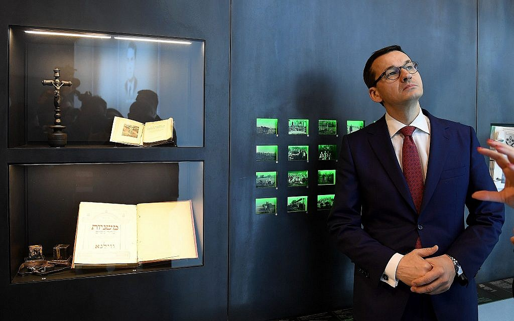 Prime Minister Mateusz Morawiecki of Poland visits the Ulma Family Museum, Jan. 2, 2018. Right-wing critics in his country accused Morawiecki of capitulating to Israel in softening a law on Holocaust rhetoric. (Janek Skarzynski/AFP/Getty Images via JTA)