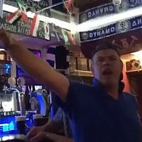 An English fan makign a Nazi salute at a Russian pub in a video published June 20, 2018. (screen capture: Twitter)