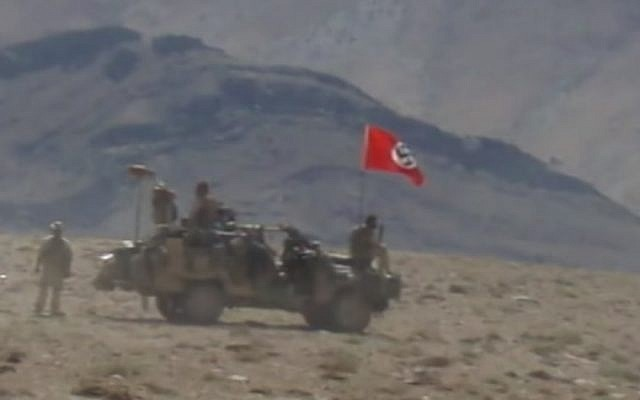 An Australian army vehicle photographed in 2007 flying a Nazi swastika flag during an operation in Afghanistan. (YouTube screenshot)