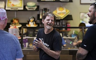 Jack Phillips, owner of the Masterpiece Cakeshop, celebrates in his Colorado store after the US Supreme Court voted 7-2 in his favor in a dispute with a gay couple, June 4, 2018. (Joe Amon/The Denver Post via Getty Images, JTA)