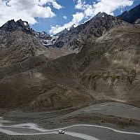 A jeep drives along the only road that leads to Spiti Valley, a remote Himalayan valley situated at 4,000 meter (13,125 feet) above sea level, India, August 15, 2016. (AP Photo/Thomas Cytrynowicz)