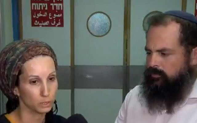 Michal (L) and Gabriel Malka, the parents of Shuva Malka, 18, who was stabbed in an apparent terror attack and hospitalized in serious condition in the northern city of Afula on June 11, 2018. (Screenshot)