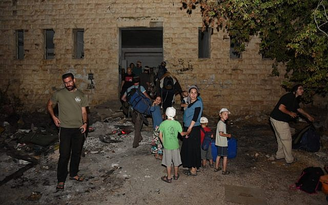 Settlers visit the evacuated settlement of Sa-Nur on July 24, 2018. (Homesh T'cheela)