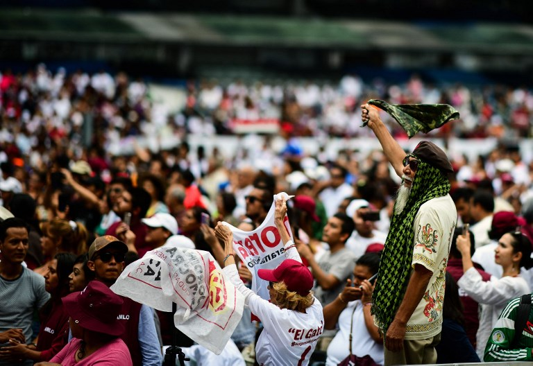 Supporters of Mexico's presidential candidate Andres Manuel Lopez Obrador at a rally at the Azteca stadium in Mexico City