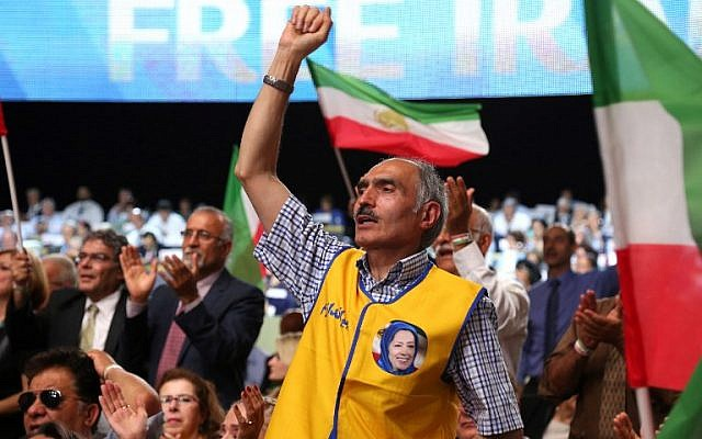 """People attend the """"Free Iran 2018 - the Alternative"""" event on June 30, 2018 in Villepinte, north of Paris during the Iranian resistance national council (NCRI) annual meeting.  (AFP/Zakaria Abdelkafi)"""