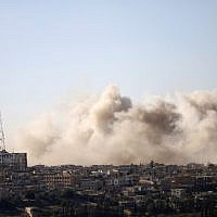 Smoke rises above rebel-held areas of the city of Daraa during airstrikes by Syrian regime forces on June 30, 2018.  (AFP/ Mohamad ABAZEED)