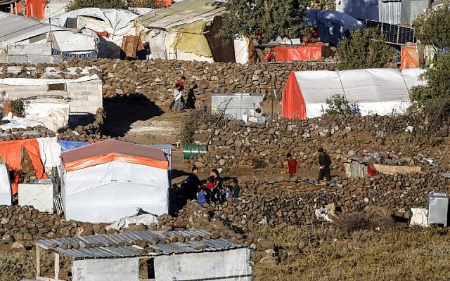 A picture taken on June 30, 2018 from the Israeli Golan Heights shows a view of a camp for displaced Syrians near the Syrian village of Burayqah in the southern province of Quneitra. (AFP Photo/Menahem Kahana)