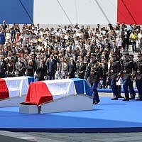 French Republican Guards arrive to carry the coffins of former French politician and Holocaust survivor Simone Veil and her husband Antoine Veil to the Pantheon in Paris on July 1, 2018 during the burial ceremony. (AFP Photo/Pool/Ludovic Marin)