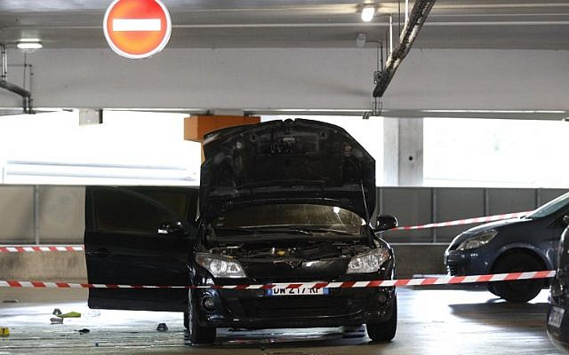 This picture taken in Aulnay-sous-Bous north of Paris on July 1, 2018, shows a car abandoned by French robber Redoine Faid at O'Parinor shopping mall parking after he escaped on a helicopter from a prison in Reau. (AFP Photo/Geoffroy Van Der Hasselt)