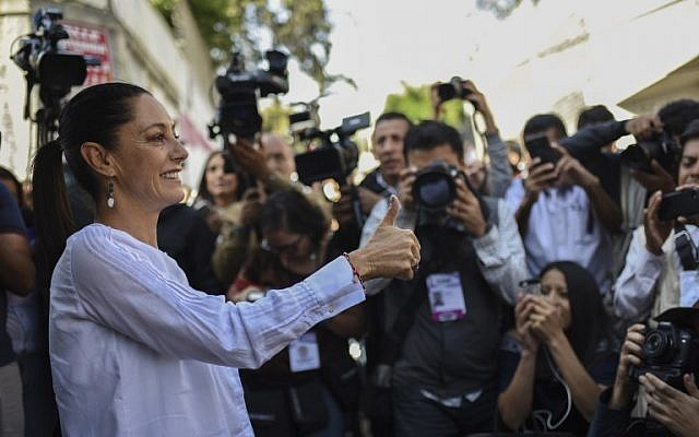 "Claudia Sheinbaum of the ""Juntos haremos historia"" coalition party, gives her thumb up after casting her vote during the general elections in Mexico City, on July 1, 2018. (AFP/ Bernardo Montoya)"