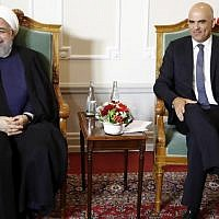 Swiss Federal President Alain Berset (R) and Iranian President Hassan Rouhani pose for a picture at the beginning of a meeting during Rouhani's official visit in Bern, on July 2, 2018 (AFP Photo/Pool/Peter Klaunzer)