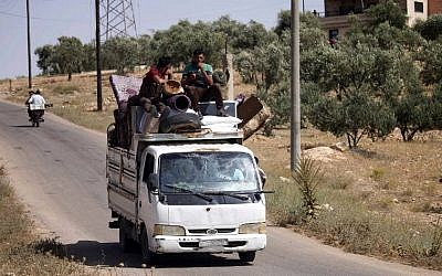 Displaced Syrians flee from government forces' bombardment on rebel-held areas of the embattled southern city of Daraa on July 3, 2018. (AFP/Mohamad ABAZEED)