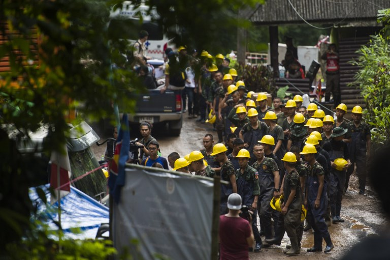 Rescue personnel arrive as rescue operations continue for 12 boys and their coach trapped at Tham Luang cave at Khun Nam Nang Non Forest Park in the Mae Sai district of Chiang Rai province