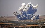 Smoke rises above rebel-held areas of the city of Daraa, during reported airstrikes by Syrian regime forces on July 5, 2018 (AFP PHOTO/Mohamad ABAZEED)
