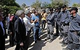 European General Consuls of France (L), Sweden, Belgium, Italy, Ireland, Switzerland, Findand, Denmark and European Union are blocked by Israeli police as they try to visit the Bedouin village of Khan al-Ahmar, in the West Bank east of Jerusalem on July 5, 2018. (AFP PHOTO / THOMAS COEX)