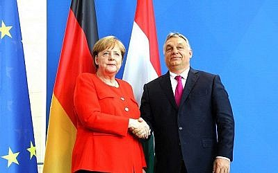 German Chancellor Angela Merkel (L) shakes hands with Hungarian Prime Minister Viktor Orban during a joint press conference following a meeting on July 5, 2018 in Berlin. (AFP PHOTO / Omer MESSINGER)