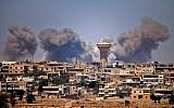 Smoke rises above rebel-held areas of the city of Daraa during reported airstrikes by Syrian regime forces on July 5, 2018.( AFP PHOTO / Mohamad ABAZEED)