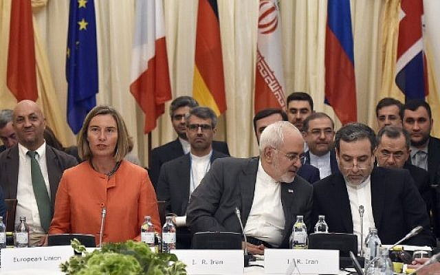 European Union High Representative for Foreign Affairs Federica Mogherini (L); Iranian Minister of Foreign Affairs Mohammad Javad Zarif (C) and political deputy at the Ministry of Foreign Affairs of Iran Abbas Araghchi take part in a Comprehensive Plan of Action (JCPOA) ministerial meeting on the Iran nuclear deal on July 6, 2018 in Vienna, Austria. (AFP/APA/Hans Punz)