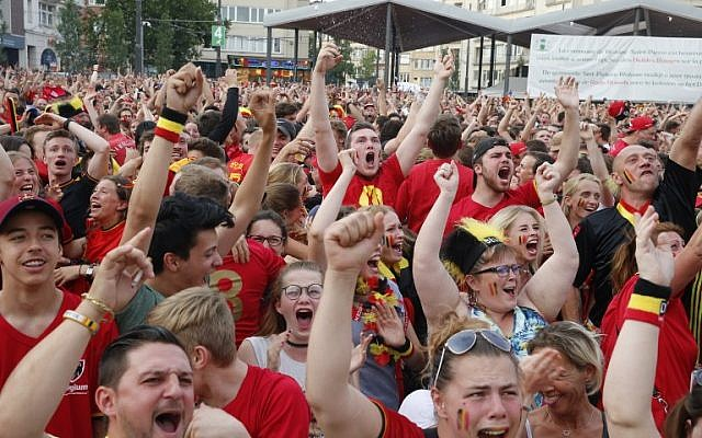 Illustrative: Belgian soccer fans celebrate after the Belgium's goal as they watch the Russia 2018 World Cup quarter-final match between Brazil and Belgium, in Woluwe, Brussels, on July 6, 2018. (AFP Photo/Belga/Nicolas Maeterlinck)