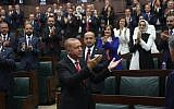 Turkish President Tayyip Erdogan greets members of parliament from his ruling AK Party (AKP) during a meeting at the Turkish parliament in Ankara, Turkey, July 7, 2018.   (AFP PHOTO / ADEM ALTAN)