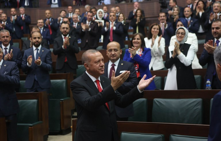 Turkish President Tayyip Erdogan greets members of parliament from his ruling AK Party during a meeting at the Turkish parliament in Ankara Turkey