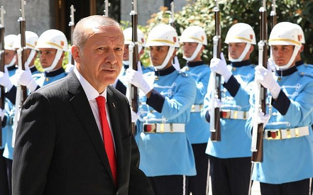 Turkey's President, Tayyip Erdogan reviews an honor guard as he arrives at the Turkish parliament in Ankara, on July 7, 2018. (AFP Photo/Adem Altan)