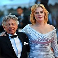 In this file photo taken on May 27, 2017 French-Polish director Roman Polanski (L) and his wife, French actress Emmanuelle Seigner, leave the Festival Palace following the screening of the film 'Based on a True Story' (D'Apres une Histoire Vraie) at the 70th edition of the Cannes Film Festival in Cannes, southern France. (AFP PHOTO / LOIC VENANCE)