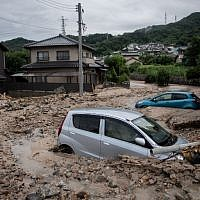 Cars trapped in the mud after floods in Saka, Hiroshima prefecture on July 8, 2018.  (Martin BUREAU/AFP)