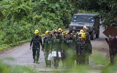 Thai soldiers walk out from the Tham Luang cave area as operations continue for the remaining boys and their coach trapped at the cave in Khun Nam Nang Non Forest Park in the Mae Sai district of Chiang Rai province on July 9, 2018. (AFP PHOTO / YE AUNG THU)