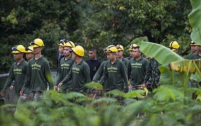 Thai soldiers walk out from the Tham Luang cave area as operations continue for the 8 boys and their coach trapped at the cave in Khun Nam Nang Non Forest Park in the Mae Sai district of Chiang Rai province on July 9, 2018. (AFP PHOTO / YE AUNG THU)