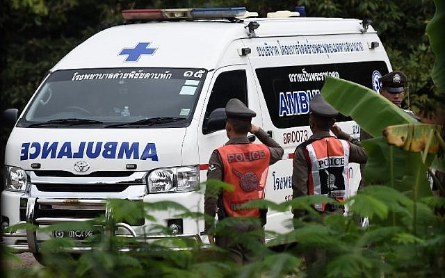 An ambulance exits from the Tham Luang cave area as operations continue for the 8 boys and their coach trapped at the cave in Khun Nam Nang Non Forest Park in the Mae Sai district of Chiang Rai province on July 9, 2018. (AFP PHOTO / YE AUNG THU)