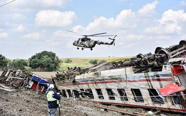 A helicopter flies over the site where a train derailed at Corlu district in Tekirdag, northwest Turkey, on July 9, 2018. (AFP PHOTO / DHA)
