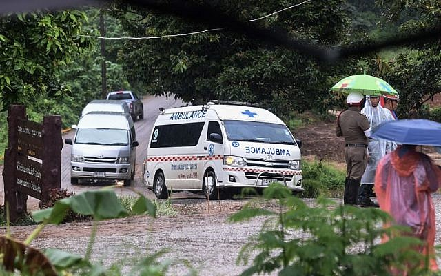 An ambulance leaves from the Tham Luang cave area as the operations continue for those still trapped inside the cave in Khun Nam Nang Non Forest Park in the Mae Sai district of Chiang Rai province on July 10, 2018. (YE AUNG THU/AFP)
