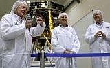 Israeli billionaire and investor Morris Kahn (L) speaks to journalists in front of a Israeli Aerospace Industries spacecraft during a press conference to announce its launch to the moon, in Yehud, near Tel Aviv, on July 10, 2018. (AFP PHOTO / THOMAS COEX)