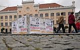 Banners with the names and pictures of victims of the National Socialist Underground (NSU) are fixed at a framework in Zwickau, eastern Germany, on July 10, 2018. (AFP / dpa / Hendrik Schmidt)