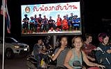 """Motorists pass a billboard with a photograph showing members of the Thai children's football team """"Wild Boar"""" and their coach with a message """"welcome home brothers"""" displayed in Chiang Rai as the boys and their coach were all rescued in the Tham Luang cave in Khun Nam Nang Non Forest Park in the Mae Sai district on July 10, 2018. (AFP PHOTO / TANG CHHIN Sothy)"""