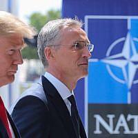 US President Donald Trump (L) walks with NATO Secretary General Jens Stoltenberg as he arrives to attend the NATO (North Atlantic Treaty Organization) summit, in Brussels, on July 11, 2018. (AFP/Pool/Tatyana Zenkovich)
