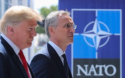 US President Donald Trump (L) walks with NATO Secretary General Jens Stoltenberg as he arrives to attend the NATO (North Atlantic Treaty Organization) summit, in Brussels, on July 11, 2018. (AFP/Pool/Tatyana Zenkovich)