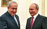 Russian President Vladimir Putin (R) shakes hands with Israeli Prime Minister Benjamin Netanyahu during their meeting at the Kremlin in Moscow on July 11, 2018. (AFP/ Pool/Yuri Kadobnov)