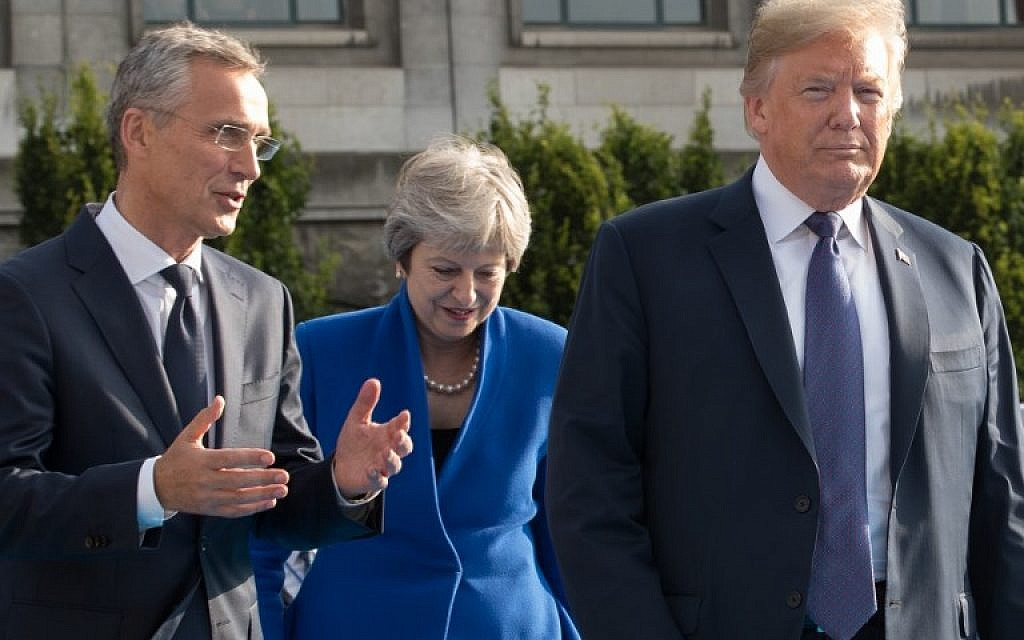 (From L) NATO Secretary General Jens Stoltenberg, Prime Minister of the United Kingdom Theresa May and US President Donald Trump arrive for a working dinner at The Parc du Cinquantenaire - Jubelpark Park in Brussels on July 11, 2018, during the North Atlantic Treaty Organization (NATO) summit.  (AFP PHOTO / POOL / BENOIT DOPPAGNE)