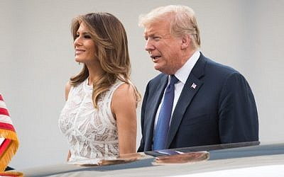 US President Donald Trump (R) and First Lady of the US Melania Trump arrive for a working dinner at The Parc du Cinquantenaire - Jubelpark Park in Brussels on July 11, 2018, during the North Atlantic Treaty Organization (NATO) summit. (AFP PHOTO / POOL / BENOIT DOPPAGNE)