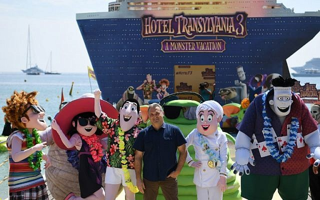 "Russian-US director Genndy Tartakovsky (C) poses during a photocall for the animated film ""Hotel Transylvania 3 : A Monster Vacation"" on the eve of the opening of the 71st edition of the Cannes Film Festival in Cannes, southern France, May 7, 2018 (AFP PHOTO / LOIC VENANCE)"