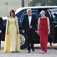 US President Donald Trump (2R) and US First Lady Melania Trump (2L) are welcomed by Britain's Prime Minister Theresa May (R) and her husband Philip May (L) as they arrive for a black-tie dinner with business leaders at Blenheim Palace, west of London, on July 12, 2018, on the first day of President Trump's visit to the UK.  (AFP/ POOL / Geoff PUGH)