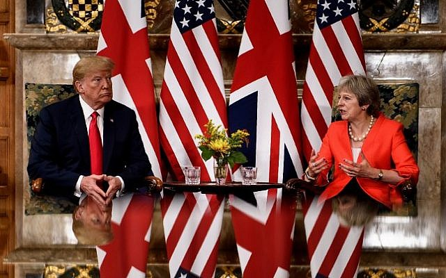 US President Donald Trump listens to Britain's Prime Minister Theresa May prior to a meeting at Chequers, the prime minister's country residence, near Ellesborough, northwest of London on July 13, 2018 on the second day of Trump's UK visit. (AFP/Brendan Smialowski)