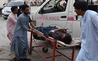 A victim of a bomb blast is brought to a hospital in Quetta on July 13, 2018 following an attack at an election rally. (AFP/Banaras Khan)