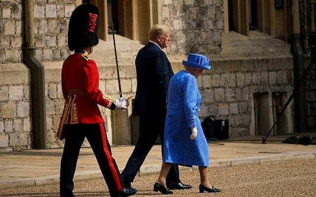 Britain's Queen Elizabeth II and US President Donald Trump walk to inspect the Guard of Honour at Windsor Castle in Windsor, west of London, on July 13, 2018 on the second day of Trump's UK visit. (AFP PHOTO / Brendan Smialowski)