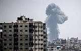 A picture taken on July 14, 2018 shows a smoke plume rising following an Israeli air strike in Gaza City (AFP PHOTO / MAHMUD HAMS)